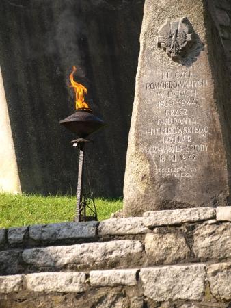 kazimierz dolny: Kazimierz Dolny, Poland - August 15, 2010: Eternal Flame memorial near patriotic statue near patriotic statue in Kazimierz Dolny, Poland