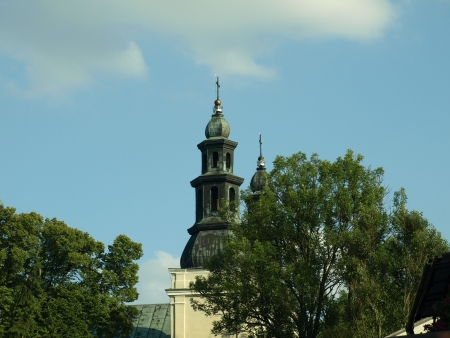 Urzedow, Poland - August 04, 2012: Old church with belfry in Urzedow, Poland