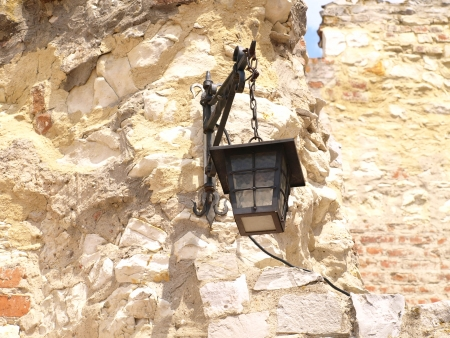 lubelskie: Lamp on old building