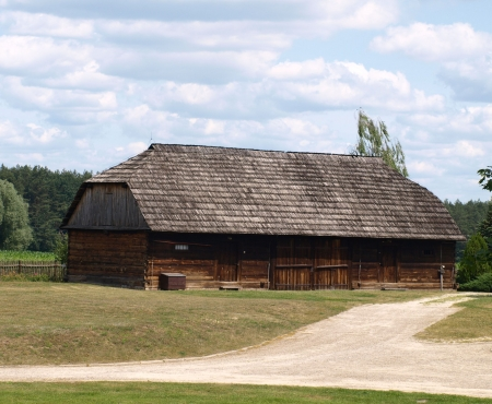 kazmierz dolny: Janowiec - Kazimierz Dolny, Poland - July 08  Wooden buildings in museum with old objects about old town Janowiec history near castle  on July 08, 2013 in small town Janowiec near Kazmierz Dolny, Poland