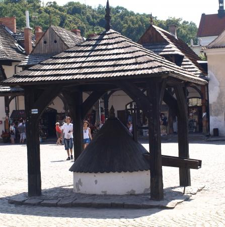 kazmierz dolny: Kazimierz Dolny, Poland - July 08  Old wooden well in Old Market Place in Kazimierz Dolny on July 08, 2013 in Kazmierz Dolny, Poland