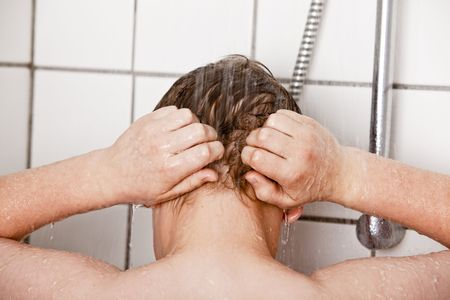 hair shampoo: Boy washing his hair in the shower