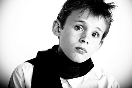Serious looking boy with freckles on his face Stock Photo - 6035393