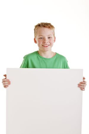 Portrait of happy boy with the empty blank sign isolated on white Stock fotó