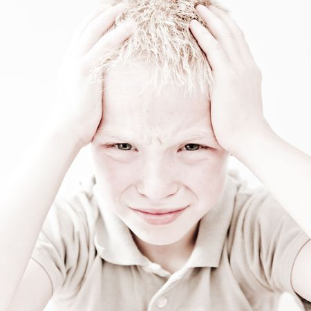 Portrait of young boy in pain from headache Stock Photo - 6406776