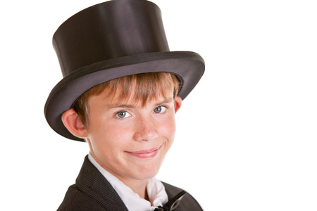 formal attire: Close up Young Boy Wearing Formal Attire with Top Hat, Looking at the Camera with Happy Face Against White Background.