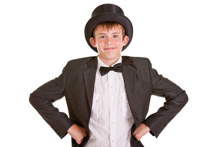 dapper: Half Body Shot of a Young Boy in Vintage Formal Wear with Top Hat, Smiling at the Camera with Hands on his Waist. isolated on White Background.