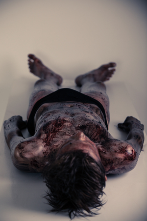 morgue: Full Body Shot of a Burnt Corpse of a Young Boy Lying on the Table Inside a Morgue