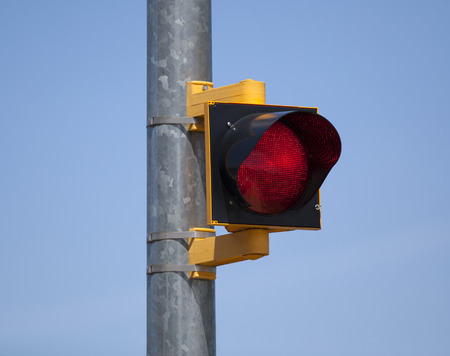 Red stop light on a pole