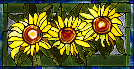 glass reflection: Stained glass sunflower pattern with 3 flowers.