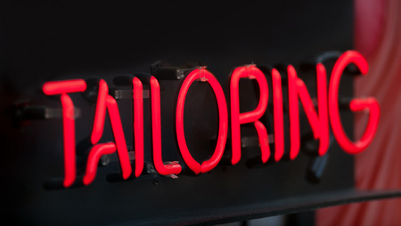 Tailoring neon sign with space for copy. Stock Photo
