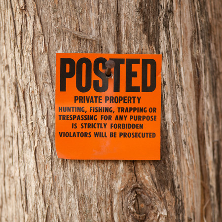 posted: Posted private property orange no hunting,fishing, trapping or trespassing for any purpose sign.