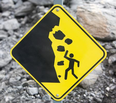 Rock fall danger warning sign. Stock Photo