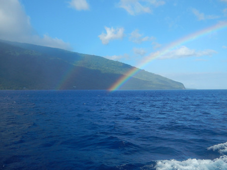 south pacific: A rainbow arks over the water near the island of Ambae in Vanuatu in the South Pacific.