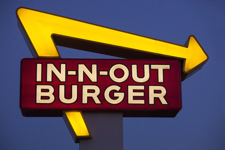 LOS ANGELES, CAUSA - MAY 24, 2015: Exterior Sign of an In-N-Out Burger restaurant. In-N-Out Burgers, Inc. is a regional chain of fast food restaurants with locations the United States Southwest.