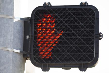 Dont walk orange stop hand signal. Stock Photo