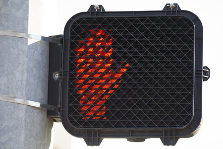 signals: Dont walk orange stop hand signal. Stock Photo