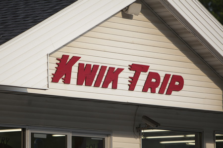 REEDSBURG, WIUSA - June 28, 2015: A view of the front facade of a Kwik Trip store located in Reedsburg, Wisconsin. Kwik Trip is a chain of convenience stores founded in 1965 with locations throughout Wisconsin and Minnesota under the name Kwik Trip.