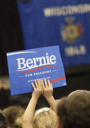 senate race: MADISON, WIUSA - July 1, 2015: A young girl holds up a Bernie Sanders for President sign during a rally of over 10,000 people for Bernie Sanders in Madison, Wisconsin.