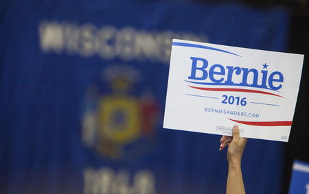 senate race: MADISON, WIUSA - July 1, 2015: A woman holds up a Bernie Sanders for President sign during a rally of over 10,000 people for Bernie Sanders in Madison, Wisconsin.