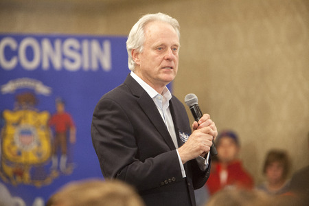 behalf: MADISON, WIUSA - March 28, 2016: Former Republican House Representative Scott Klug speaks on behalf of Republican presidential candidate John Kasich during a town hall event before the Wisconsin presidential primary.