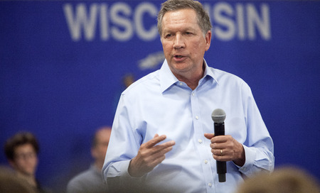 speaking: MADISON, WIUSA - March 28, 2016: Republican presidential candidate John Kasich speaks to a group of supporters during a town hall event before the Wisconsin presidential primary in Madison, Wisconsin.