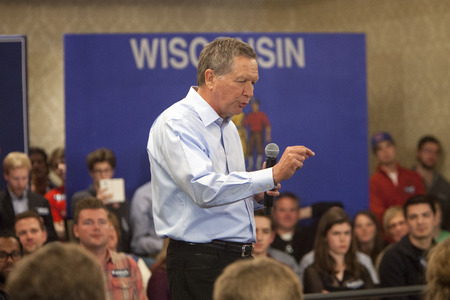 campaigning: Madison, Wisconsin, USA - March 28, 2016: Republican presidential candidate John Kasich speaks to a group of supporters during a free public town hall event before the Wisconsin presidential primary in Madison, Wisconsin. Editorial