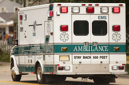 Emergency ambulance with lights on.