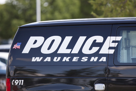 WAUKESHA, WI/USA - July 13, 2015: A Waukesha police van is parked in front of the Waukesha Convention Center during a progressive political protest against Governor Scott Walker.
