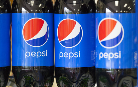 liter: LODI, WIUSA - July 26, 2015: Two liter bottles of regular Pepsi stacked on a store shelf. Pepsi is a major brand of soft drink distributed throughout the world since its inception in 1893. Editorial