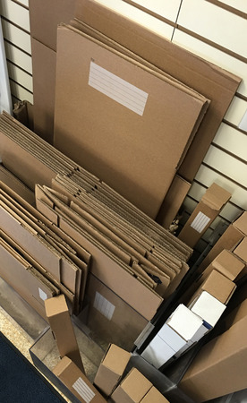 shipping supplies: Cardboard packing and shipping boxes and materials. Stock Photo