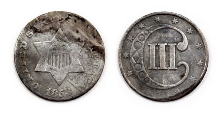 obverse: An 1853 United States three cent (3 cent) coin reverse and obverse up close.