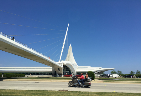 Milwaukee: MILWAUKEE, WIUSA - June 25, 2016: The iconic Milwaukee Art Museum as seen from the city as people enjoy a sunny day in Milwaukee, Wisconsin.