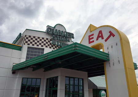 quaker: MIDDLETON, WIUSA - July 7, 2016: The front facade of the Quaker Steak & Lube automobile-themed Restaurant famous for steak, chicken and american cuisine in Middleton, Wisconsin.