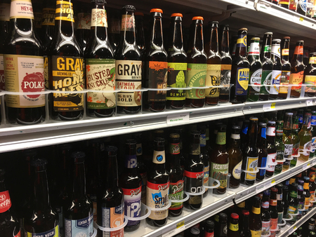 MADISON, WI/USA - November 7, 2016: A selection of microbrew beer, craft, IPA, domestic and imported beers from around the world for sale at a local grocery store in Madison, Wisconsin.