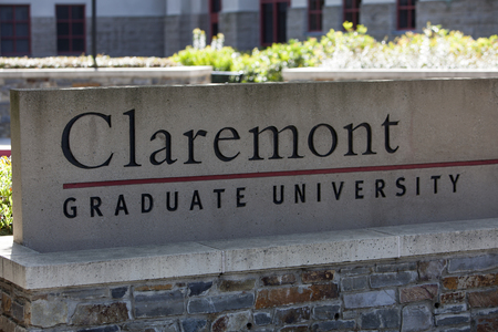 Claremont, CA, USA - April 14, 2017: The sign for Claremont Graduate University, a liberal arts college in southern California just outside of Los Angeles. Sajtókép