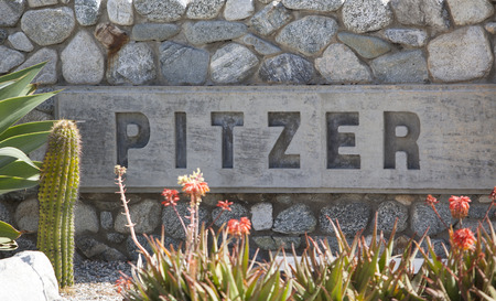 Claremont, CA, USA - April 14, 2017: The sign for Pitzer College, a liberal arts college in southern California just outside of Los Angeles. Sajtókép