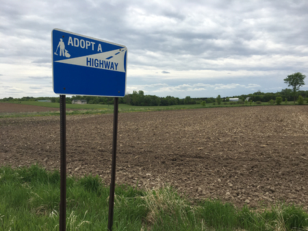 Rural adopt a highway sign with space for copy.