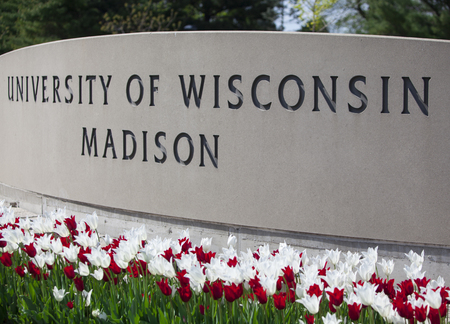 Madison, WI, USA - May 12, 2017: The University of Wisconsin crest and welcome sign is seen near the entrance to the UW Madison campus in Madison on May 8, 2015.