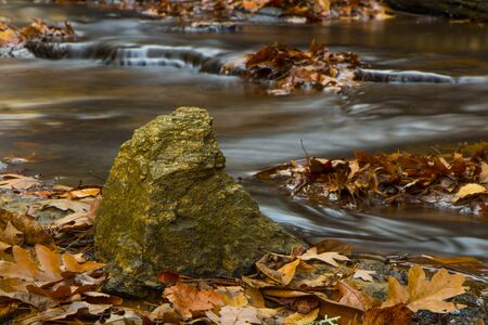 Water flowing round rocks in the Smoky Mountains during fall Stock Photo