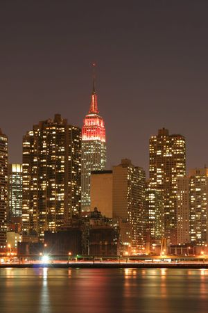 Manhattan skyline and the Empire State Building at Night Stock Photo