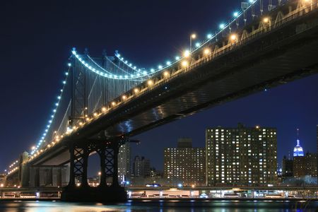 Manhattan Bridge and Manhattan skyline At Night Lights, NYC photo