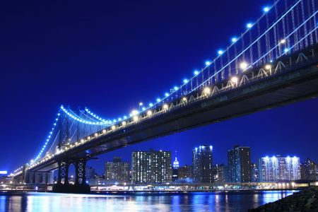Manhattan Bridge and Manhattan skyline At Night Banco de Imagens
