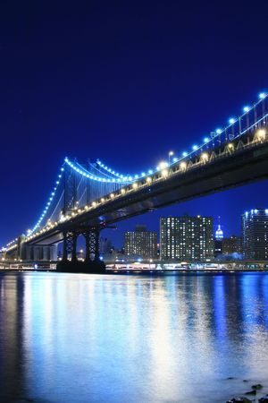 Manhattan Bridge and Manhattan skyline At Night Stock Photo