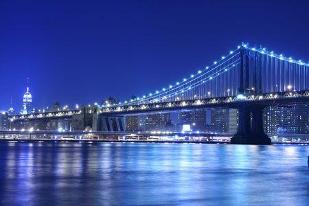 Manhattan Bridge and Manhattan skyline At Night Stock Photo