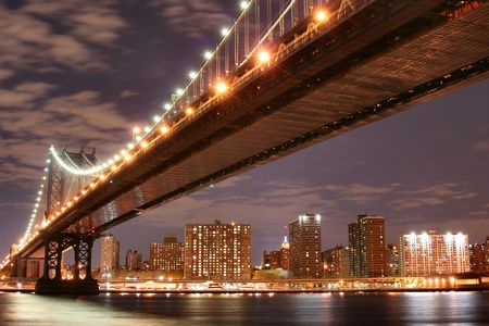 Manhattan Bridge and Manhattan skyline At Night photo