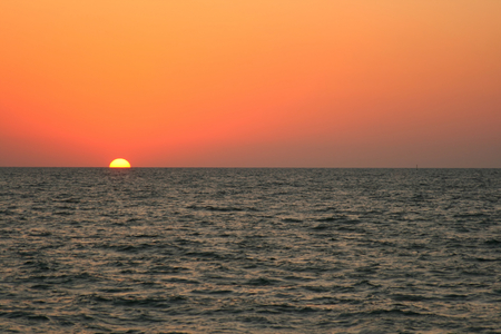 Red and orange sunset over the Sea.  Stock Photo