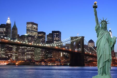 Manhattan skyline, brooklyn Bridge and the Statue of Liberty at night