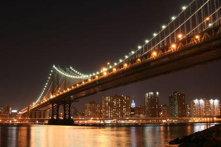 Manhattan Bridge and Manhattan skyline At Night Stock Photo - 3558169