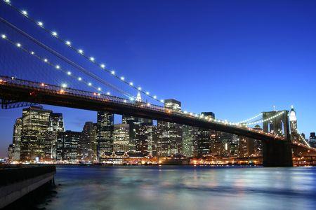 river scape: Brooklyn Bridge and Manhattan skyline At Night, New York City